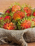Asian fruit rambutan on sack Stock Photo