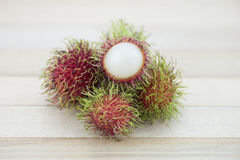 Asian fruit rambutan on wood background. Fresh rambutan Royalty Free Stock Images