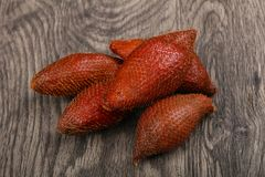 Asian fruit - sala. On the wood background Royalty Free Stock Photo