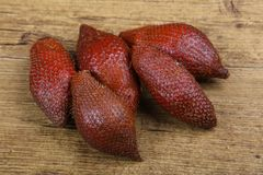 Asian fruit - sala. On the wood background Stock Images