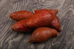 Asian fruit - sala. On the wood background Stock Image
