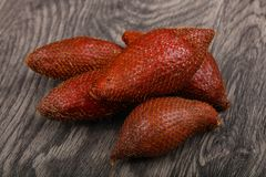 Asian fruit - sala. On the wood background Royalty Free Stock Image