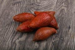 Asian fruit - sala. On the wood background Stock Photo