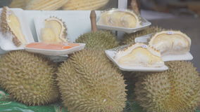 Asian fruits durian and pomelo on a market stall.  stock footage