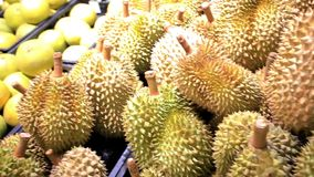 Asian fruits durian and pomelo on a market stall. Asian fruit durian and pomelo on a market stall. 1920x1080 stock footage