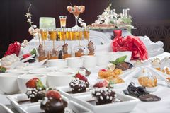 Asian Fusion appetizers and desserts on table Royalty Free Stock Photo