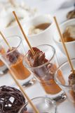 Asian Fusion lamb on stick in shot glass Stock Photography