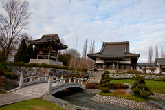 Asian Garden. Temple landscape or landmark with asian style. Japanese Garden with a lot of bonsai, a river and also a bridge. Typical for a chinese garden are Royalty Free Stock Photos