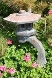 Asian Garden Statue. Set amongst plants Royalty Free Stock Photo