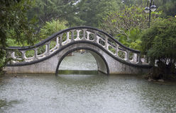 Asian garden with traditional arch bridge Stock Image