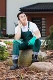 Asian gardener during break Royalty Free Stock Photos