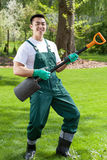 Asian gardener having fun in garden Stock Photography