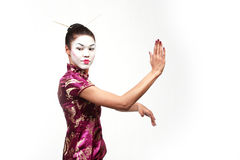 Asian geisha tai chi pose. Asian woman with geisha make up and cute Chinese dress does tai chi exercise pose Royalty Free Stock Photos