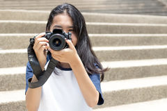 Asian gil take photo. Close up lens camera in asian girl teenage hand to take photo Stock Photos