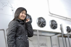 Asian girl. Portrait of asian girl with industrial surround Royalty Free Stock Image