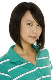 Asian Girl. A cute asian teenager in green shirt on white background royalty free stock images