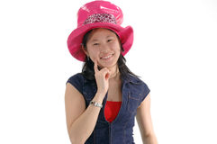 Asian Girl 2. Young Asian woman in a silly pink hat stock photography