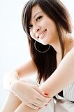 Asian Girl. A cute young Asian teenager in white dress on white background Stock Images