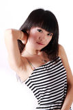 Asian girl. A beautiful Asian girl on white background Royalty Free Stock Images