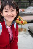 Asian Girl. A sweet-looking young asian woman in the park royalty free stock photography