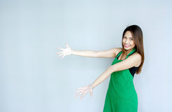 asian girl action with green apron suite Stock Photo