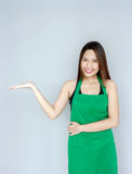 Asian girl action with green apron suite Stock Photos