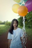 Asian,Girl alone holding balloon colorfull Royalty Free Stock Photography