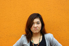 An asian girl with angry face. She shows a very angry expression, probably she just faced something unexpected Royalty Free Stock Photography
