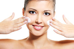 Asian girl apply cosmetic cream on  face Royalty Free Stock Images