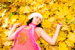 Asian girl in autumn park Royalty Free Stock Image
