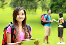 Asian girl with backpack in the park Stock Images