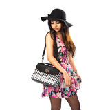 Asian girl with bag posing. Isolated over white royalty free stock photo