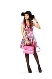Asian girl with bag posing. On white background royalty free stock photo