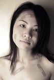 Asian girl with bandages Stock Photography
