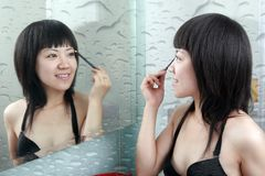 Asian girl in the bathroom Stock Photo