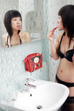 Asian girl in the bathroom Stock Images