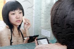 Asian girl in the bathroom Royalty Free Stock Photos