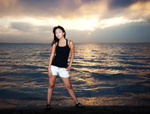 Asian girl on the beach. Cute asian girl stay on the beach Royalty Free Stock Photography