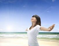 Asian girl on beach. Asian girl freedom relaxation concept photo on a beach stock photos