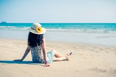 Asian girl on the beach. Cute Asian girl on the beach, at White sand beach in Koh Chang, Trat, Thailand alone attractive beautiful blue coast day dress female royalty free stock image