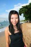 Asian girl on a beach in Thailand. Asian girl on Pattaya beach in Thailand stock photos