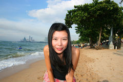 Asian girl on a beach in Thailand. Asian girl on Pattaya beach in Thailand royalty free stock photo
