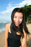 Asian girl on a beach in Thailand. Royalty Free Stock Photography