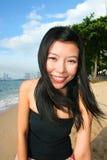 Asian girl on a beach in Thailand. Asian girl on Pattaya beach in Thailand royalty free stock photography