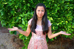 Asian girl. Beautiful asian girl confused expression Stock Photos