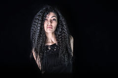 Asian girl with beautiful curly hair in black dress Stock Photography