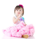 Asian girl. Beautiful asian girl sitting on the floor and holding lollipop Royalty Free Stock Photos