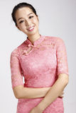 Asian beauty smiles and cheongsam Stock Images
