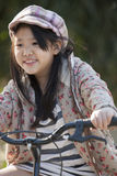 Asian girl Biking. Cute asian girls are happy with her bike stock images