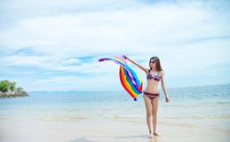 Asian girl in bikini on the beach. Asian girl in bikini relaxing on the beach royalty free stock photo